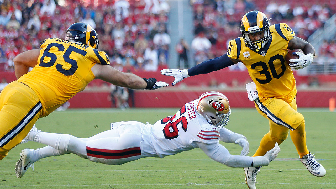Rams running back Todd Gurley II (30) runs past San Francisco 49ers linebacker Reuben Foster (56) to score a touchdown during game in Santa Clara, Calif., Sunday, Oct. 21, 2018.