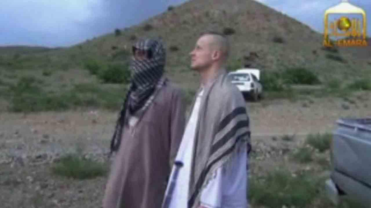 Sgt. Bowe Bergdahl, right, stands with a Taliban fighter in eastern Afghanistan in this undated file photo.