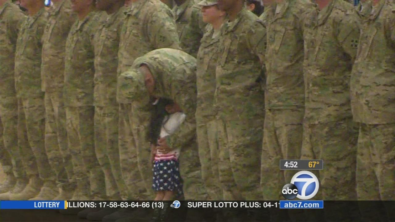 Two-year-old Karis Oglesby ran across the gymnasium during the middle of a military homecoming ceremony to hug her father.