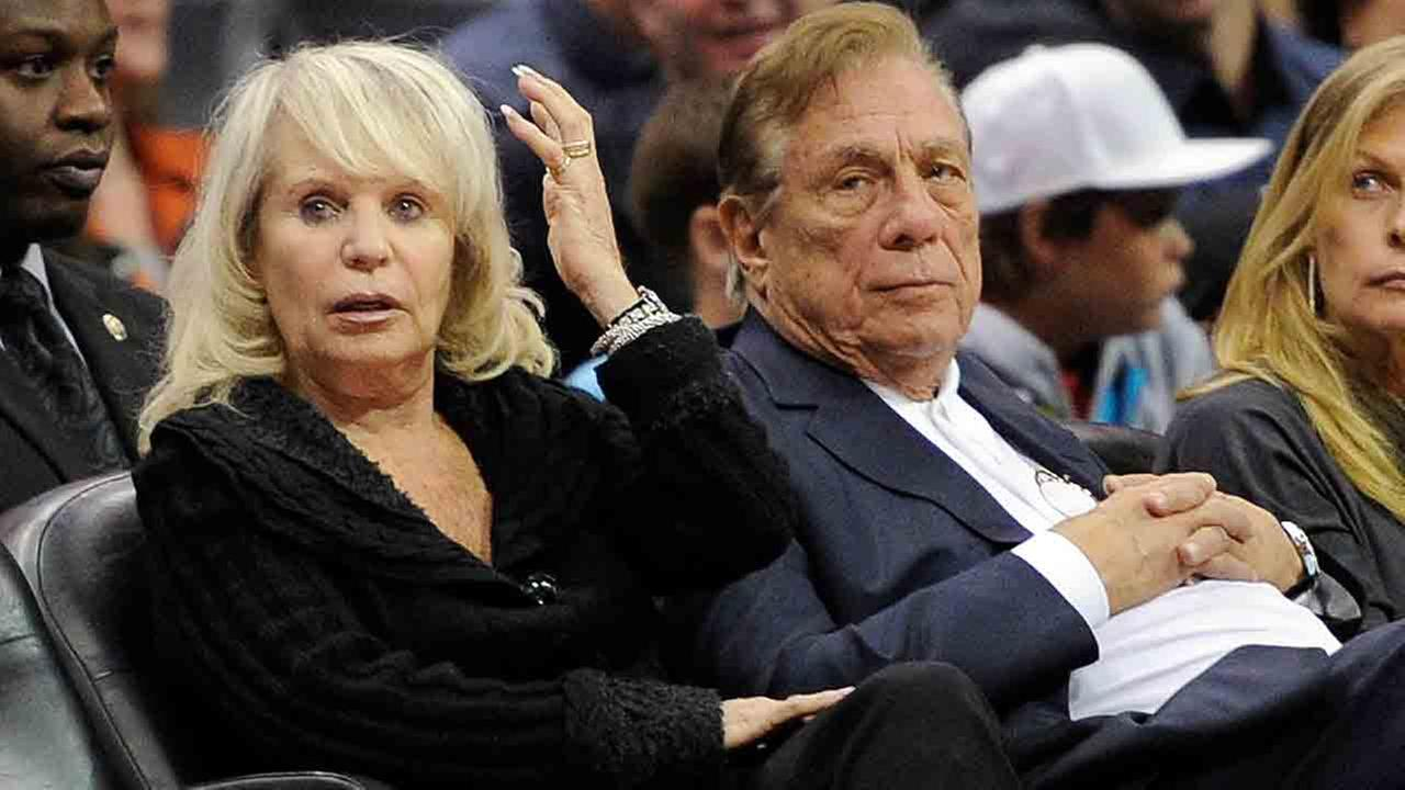 In this Nov. 12, 2010, file photo, Shelly Sterling sits with her husband, Donald Sterling, right, during the Los Angeles Clippers NBA basketball game against the Detroit Pistons.