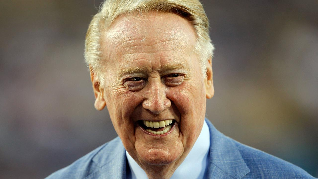 Los Angeles Dodgers broadcaster Vin Scully is honored before a baseball game against the Arizona Diamondbacks in Los Angeles, Wednesday, Sept. 23, 2015.