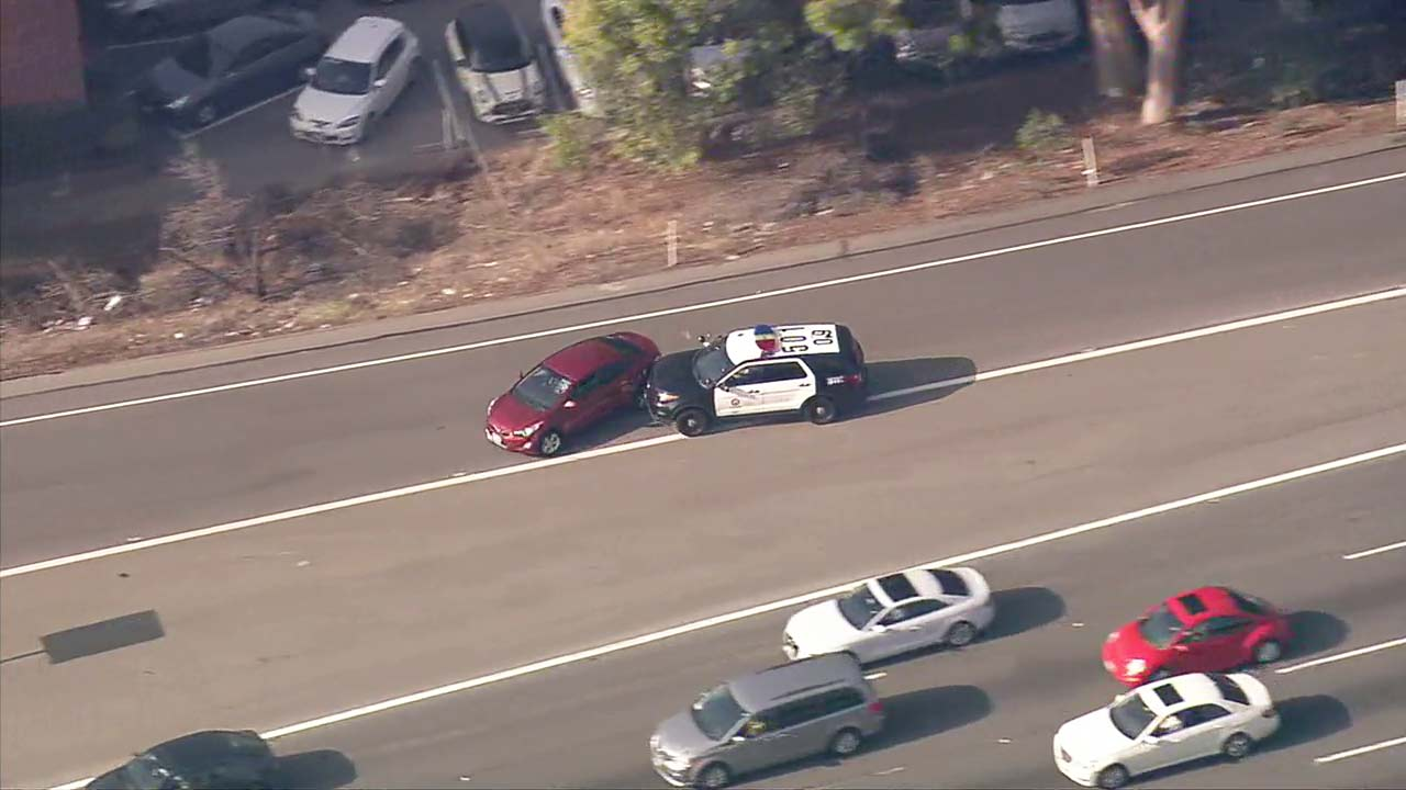 Police conduct a PIT maneuver during a chase of an assault suspect in North Hollywood on Oct. 25, 2018.