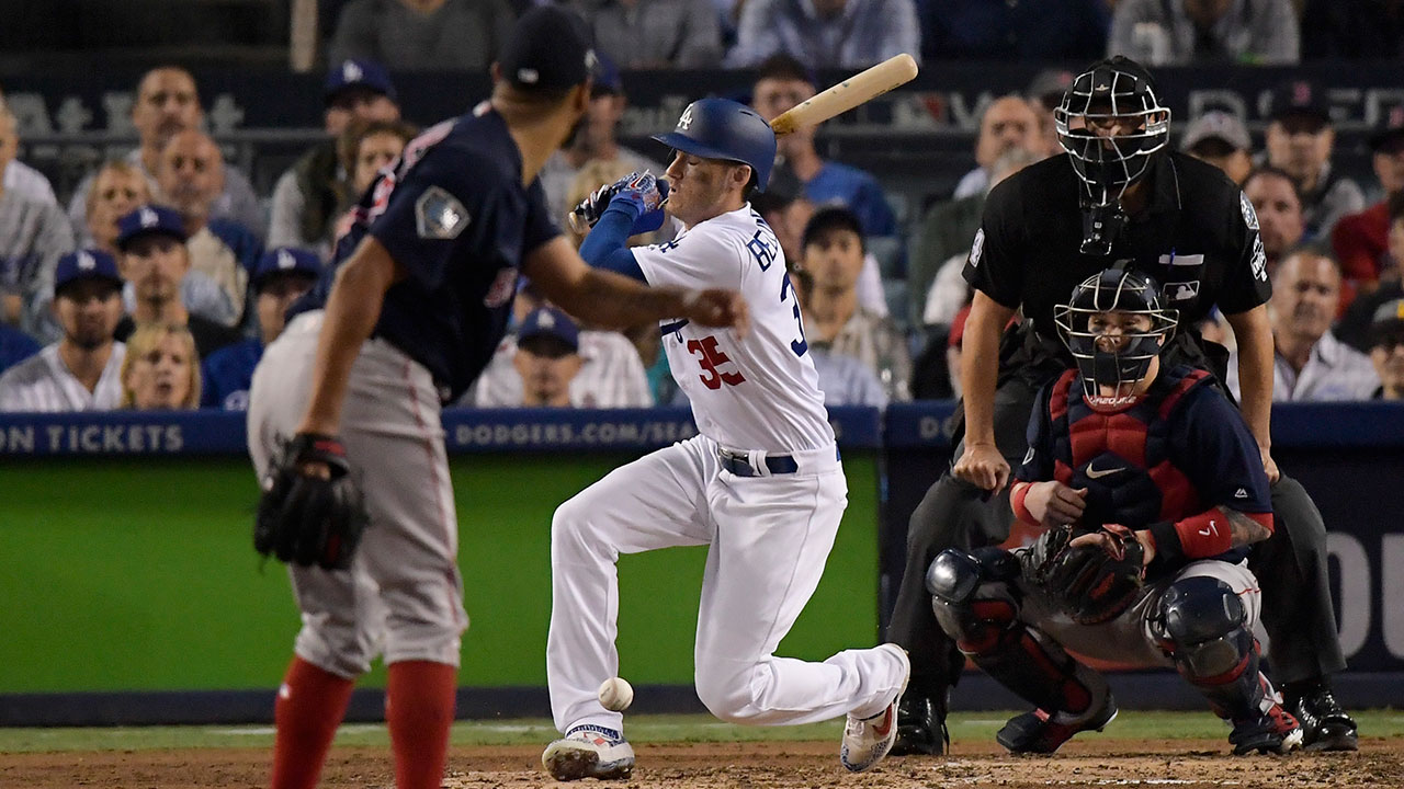 Boston Red Sox catcher Christian Vazquez watches as Los Angeles Dodgers Cody Bellinger reacts after hitting his leg with a foul tip during the fourth inning in Game 4 of the World Series.
