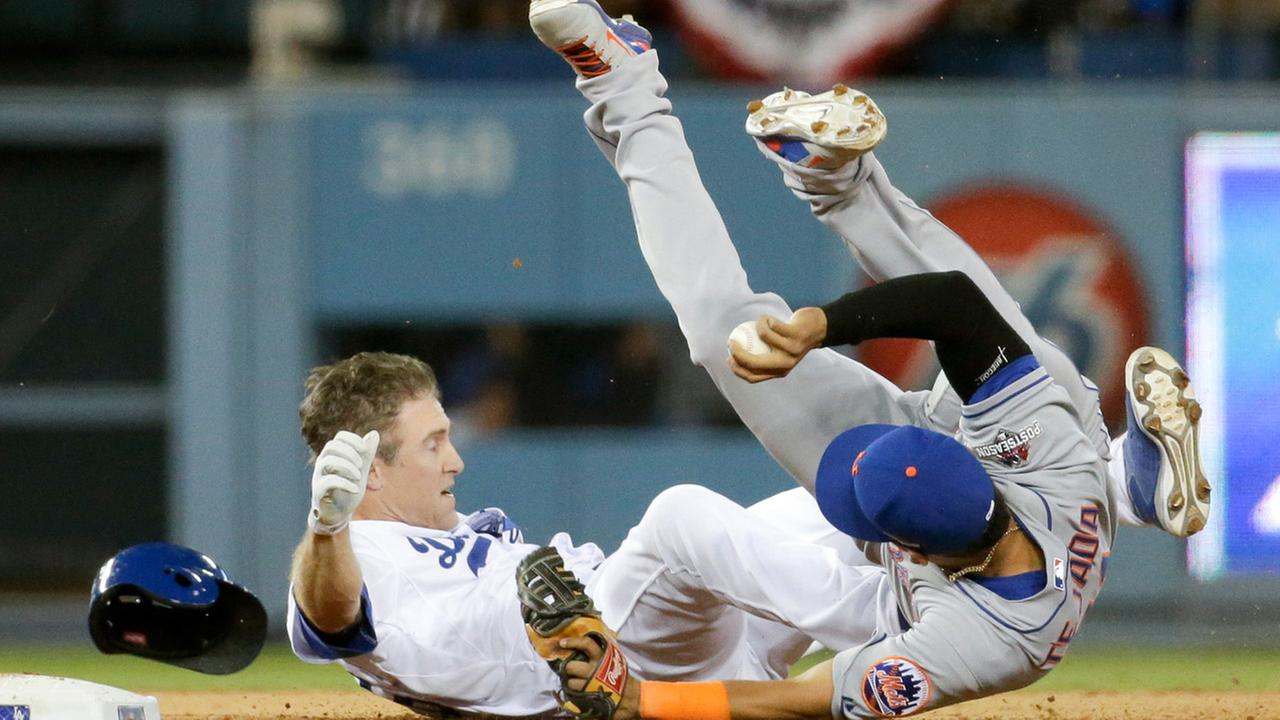 New York Mets shortstop Ruben Tejada, goes over the top of Los Angeles Dodgers Chase Utley who broke up a double play in Game 2 of baseballs NLDS, Saturday, Oct. 10, 2015.