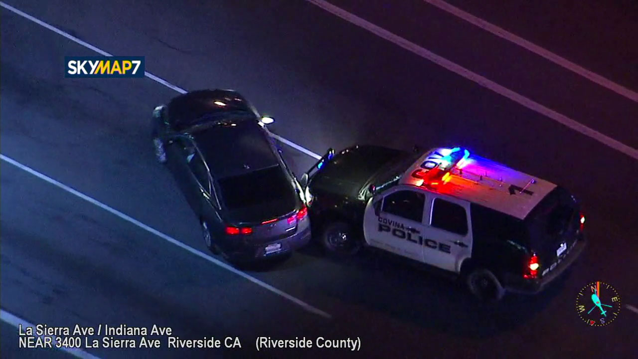 A police vehicle performs a successful PIT maneuver to stop a chase in Riverside on Tuesday, Oct. 30, 2018.