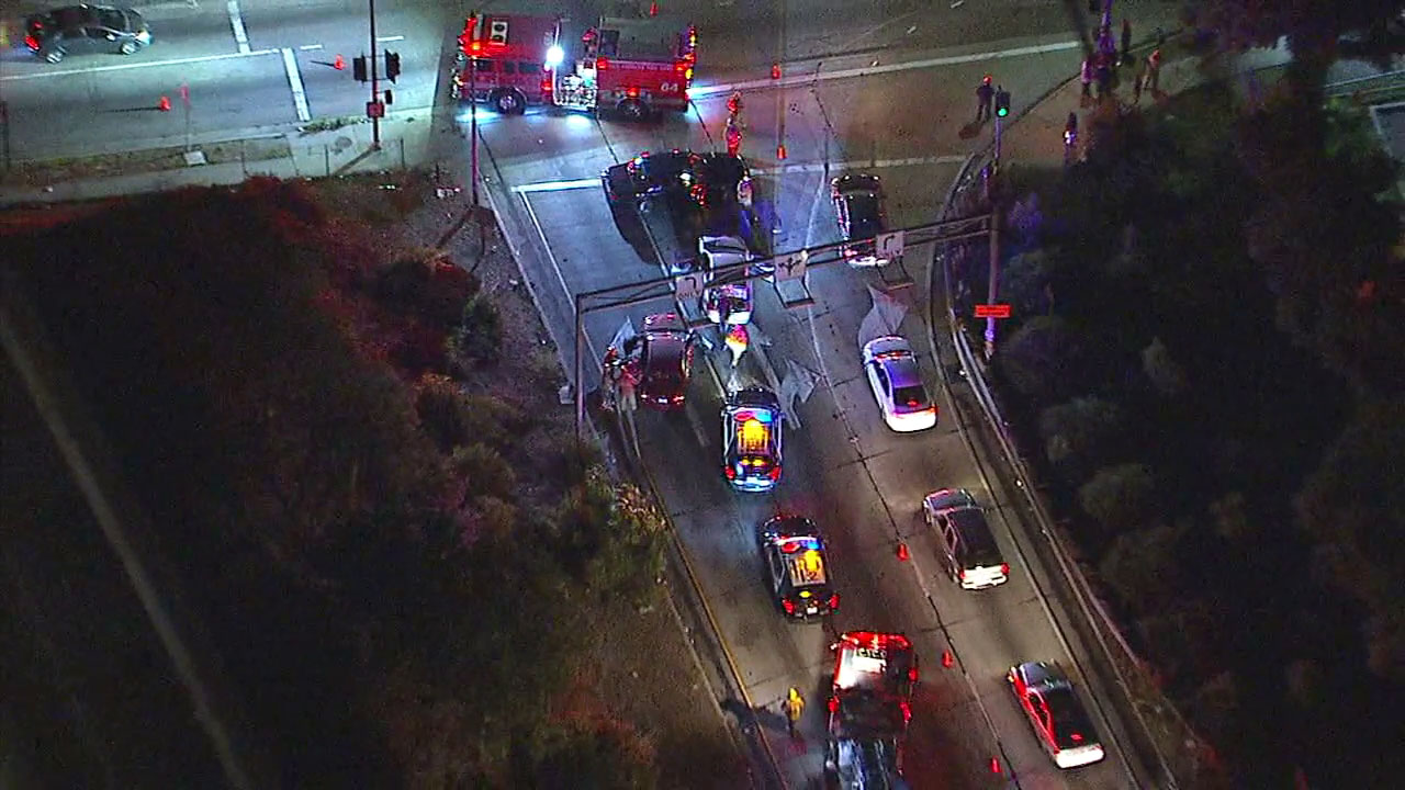 A suspect fleeing police crashed into a car carrying three infants and then ran onto the 105 Freeway in the Watts area, officials said.