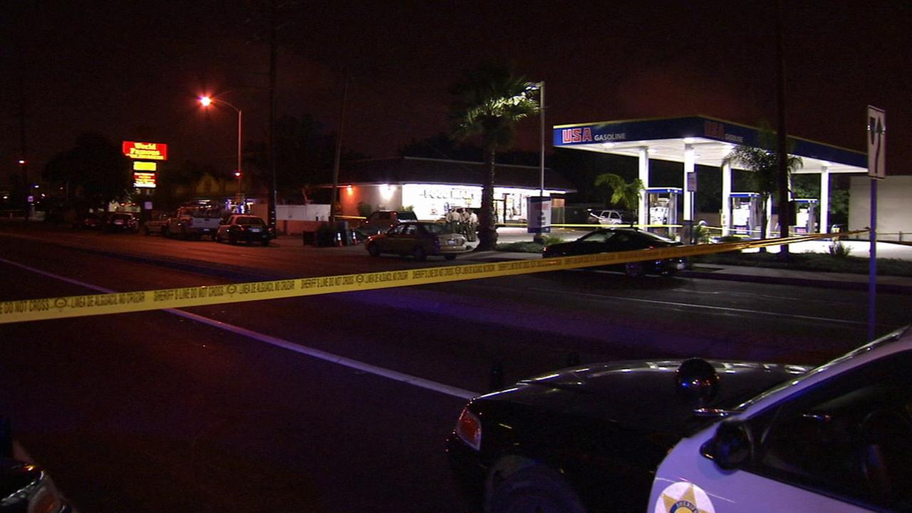 Authorities investigate the scene of a fatal shooting that left a teen dead in Carson on Saturday, Oct. 17, 2015.