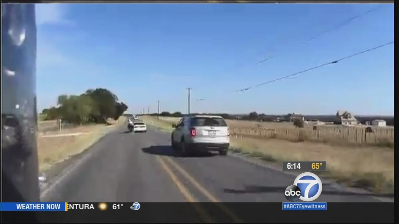A helmet camera captured the moment a vehicle swerved and hit a passing motorcycle in north Texas on Saturday, Oct. 17, 2015.