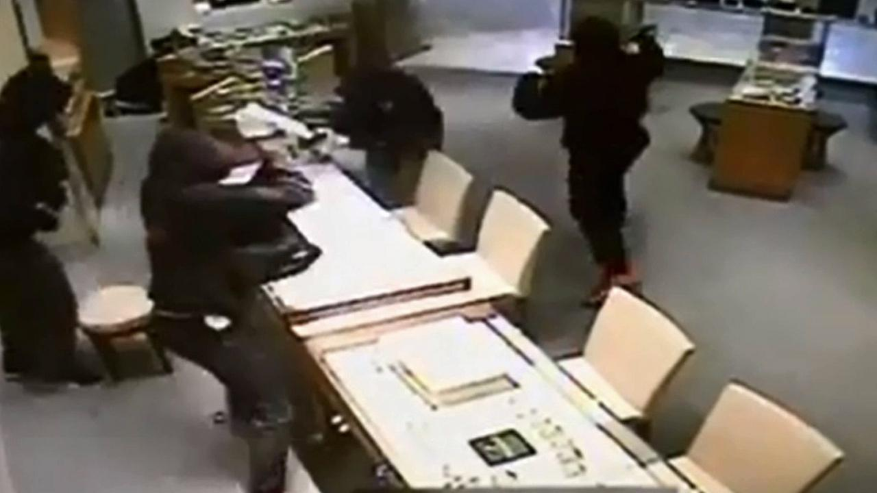 Four armed suspects use mallets to smash through glass cases and steal jewelry from a jewelry store in Mission Viejo on Wednesday, Oct. 21, 2015.