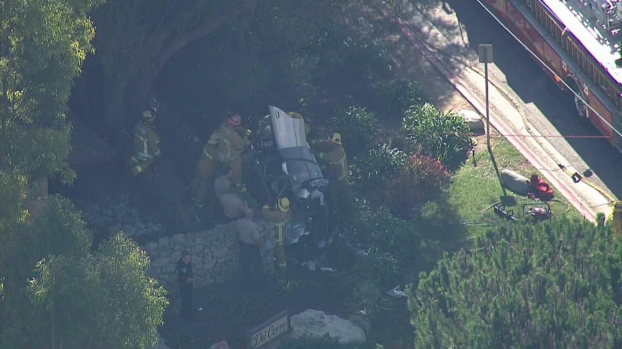 Burglary suspects led sheriffs deputies on a high-speed chase that ended with the car flipping on its side in Rancho Palos Verdes on Friday, Oct. 23, 2015.