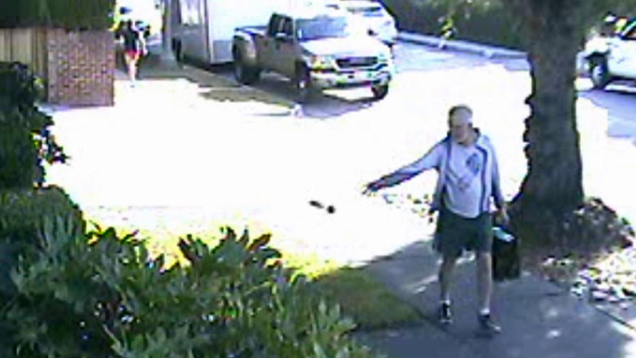 San Marino Mayor Dennis Kneier tosses a bag of poop on a neighbors property on Saturday, June 7, 2014.