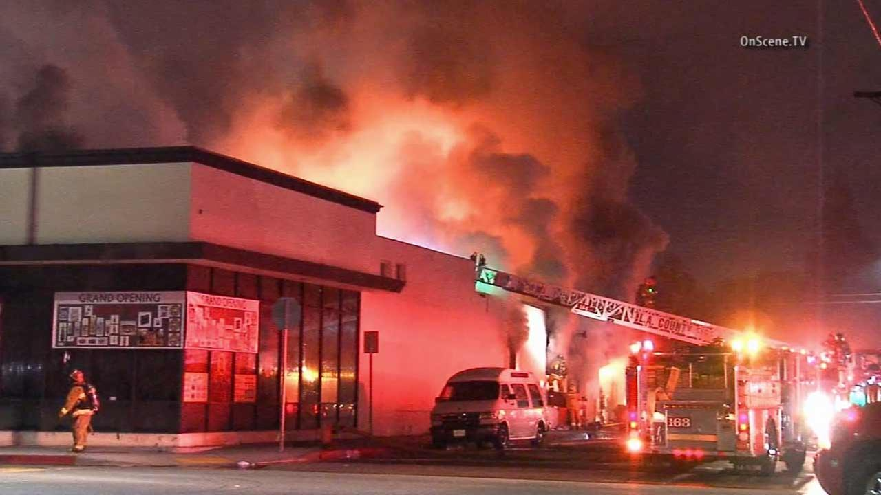 Los Angeles County firefighters battle a fire at a commercial building near E. 57th Street and Pacific Boulevard in Huntington Park on Wednesday, Oct. 28, 2015.
