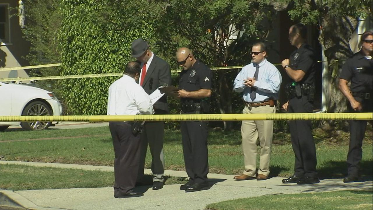 Authorities investigate a deadly shooting in the 3600 block of Purdue Avenue in the Mar Vista area of Los Angeles on Saturday, Oct. 31, 2015.