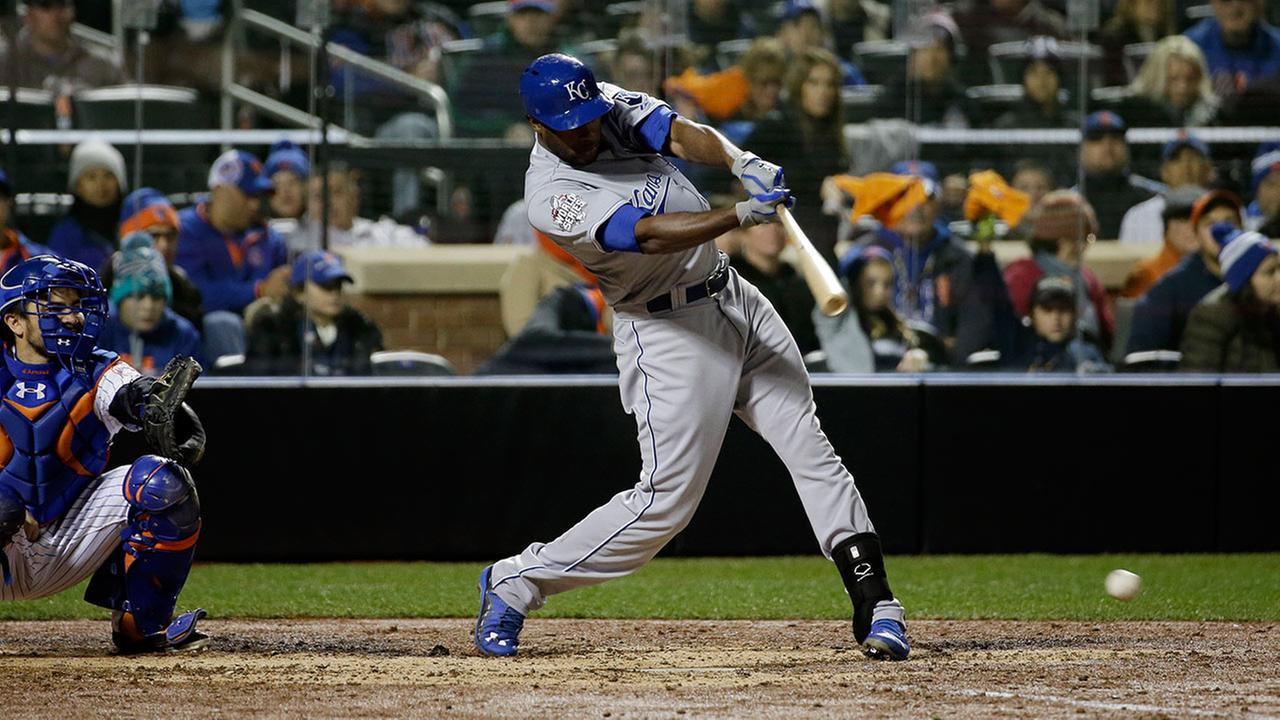 Kansas City Royals Lorenzo Cain hits an RBI single during the sixth inning of Game 4 of the Major League Baseball World Series against the New York Mets Saturday, Oct. 31, 2015, in New York.