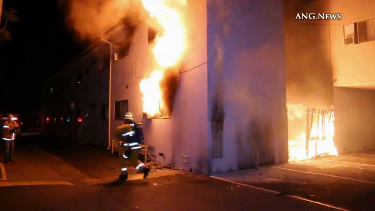 Los Angeles City Fire Department officials battle an apartment blaze in Sun Valley Sunday, Nov. 1, 2015.