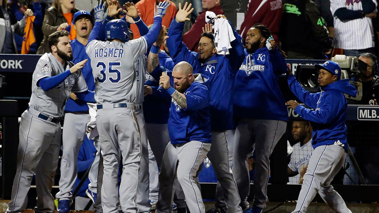 Kansas City Royals Eric Hosmer is congratulated after scoring during the ninth inning of Game 5 of the Major League Baseball World Series against the New York Mets on Sunday.