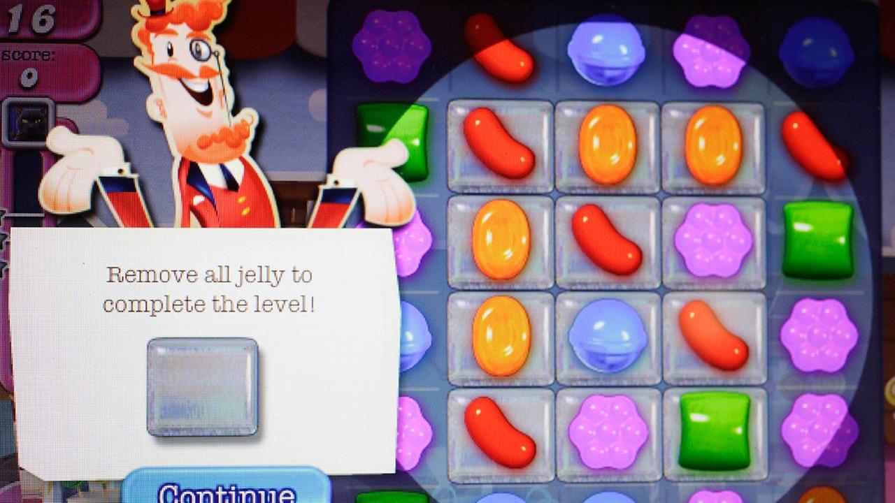 In this March 24, 2014, file photo, a detail from the online game Candy Crush Saga is shown on a computer screen in New York.
