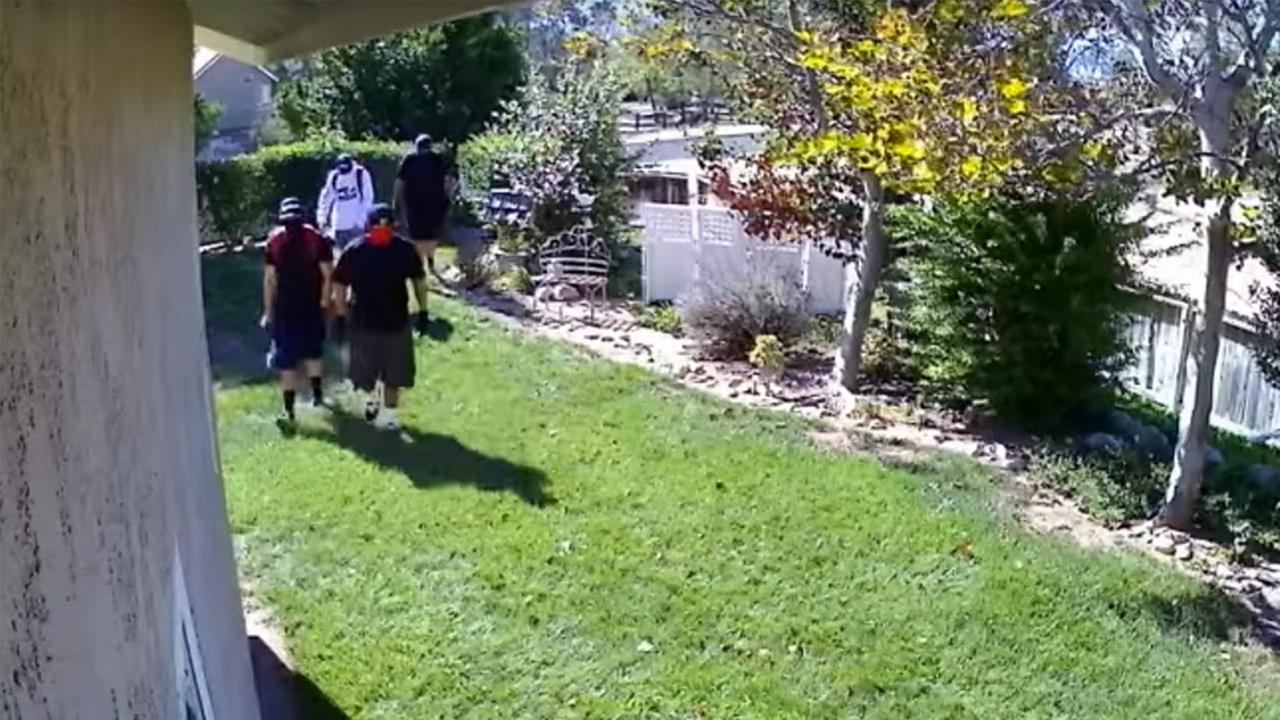 Surveillance video captures four suspects on Oct. 30, 2015, who are wanted in a string of Highland burglaries.