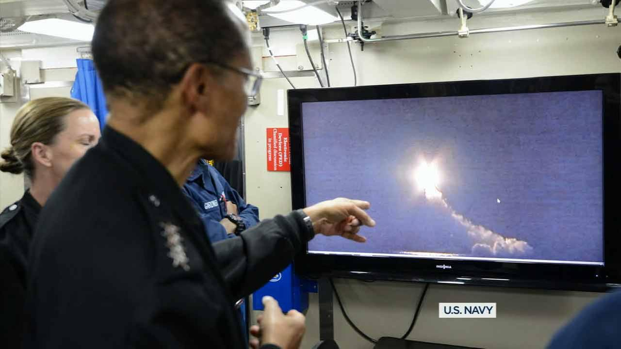 Adm. Cecil D. Haney watches a video recording of the 156th successful test flight of an unarmed Trident II D5 missile, Nov. 7, 2015.