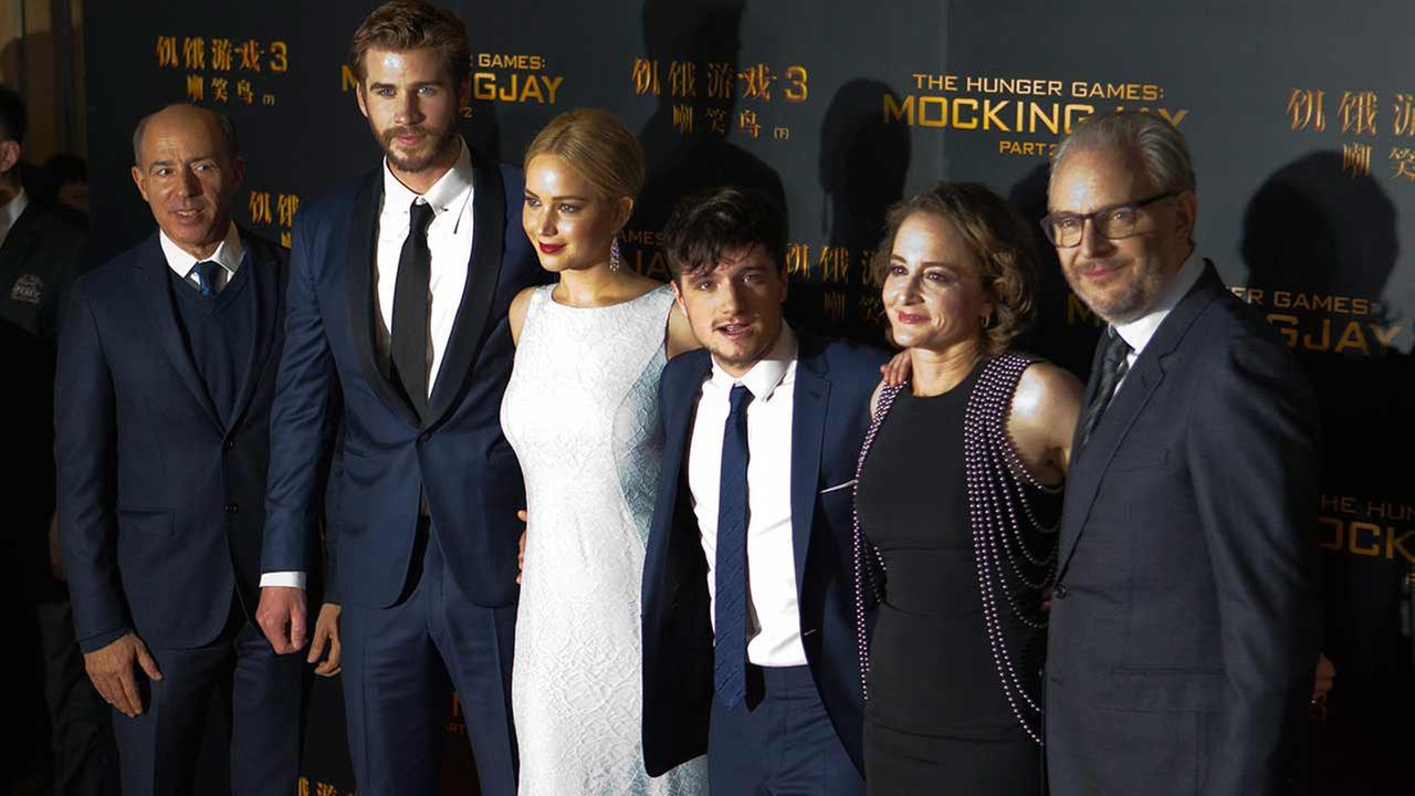 Jon Kilik, Liam Hemsworth, Jennifer Lawrence, Josh Hutcherson, Nina Jacobson and Francis Lawrence pose for photographers at an event for The Hunger Games: Mockingjay - Part 2.