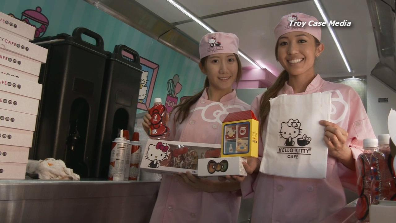 Employees with the Hello Kitty Cafe pose for a picture.