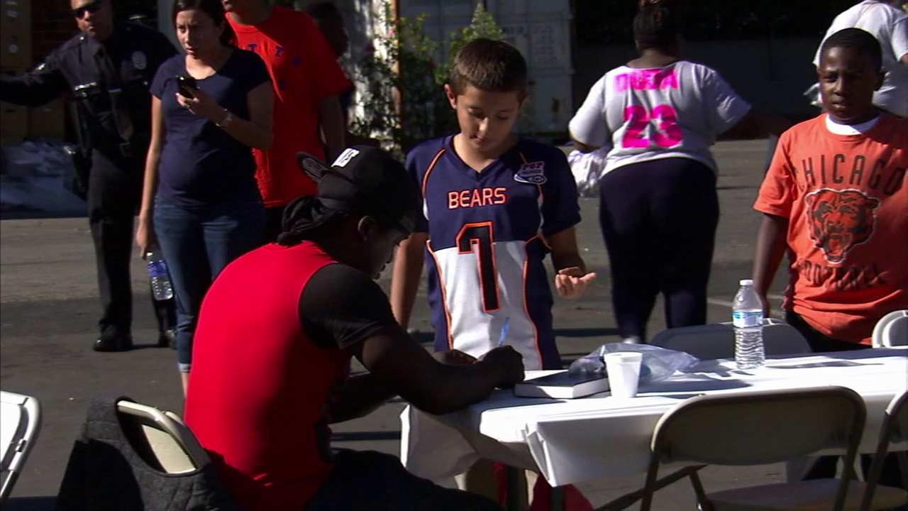 A Watts Bears football team member volunteers during the teams first Thanksgiving meal for the needy Sunday, Nov. 22, 2015.