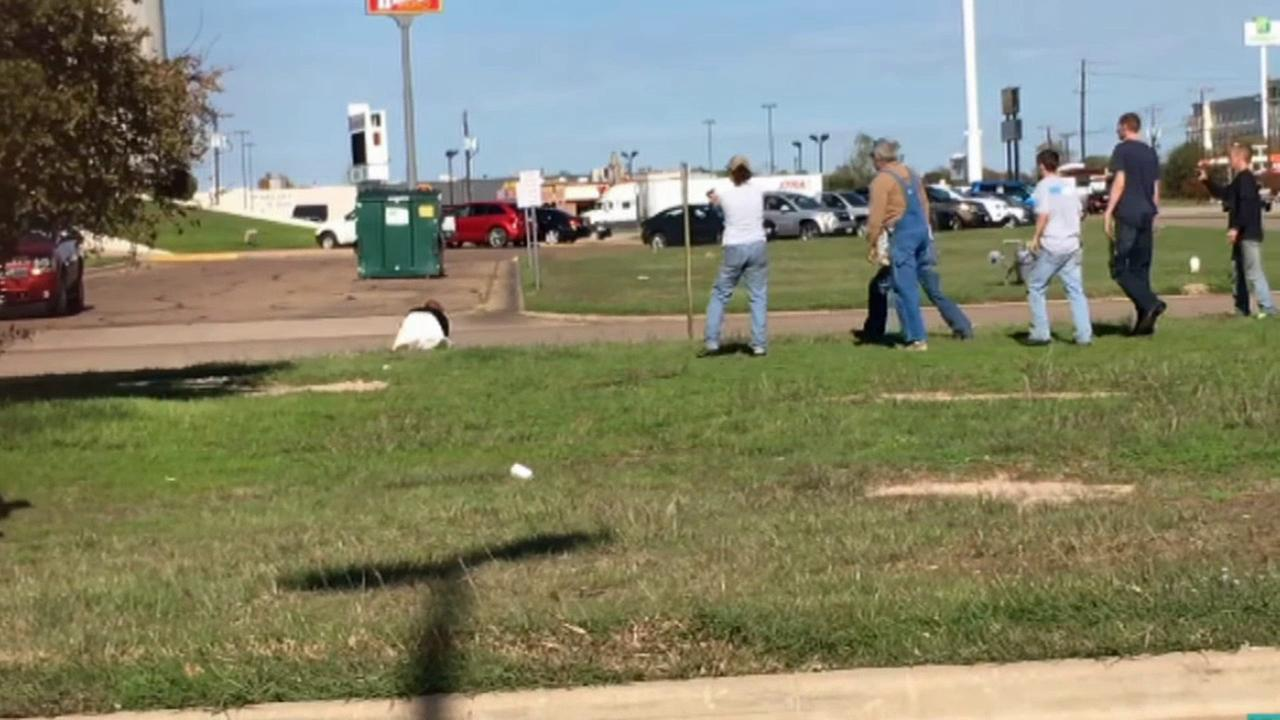 Shoppers work together to catch a man police said snatched a purse from an elderly lady at a Walmart in Waco, Texas on Monday, Nov. 23, 2015.