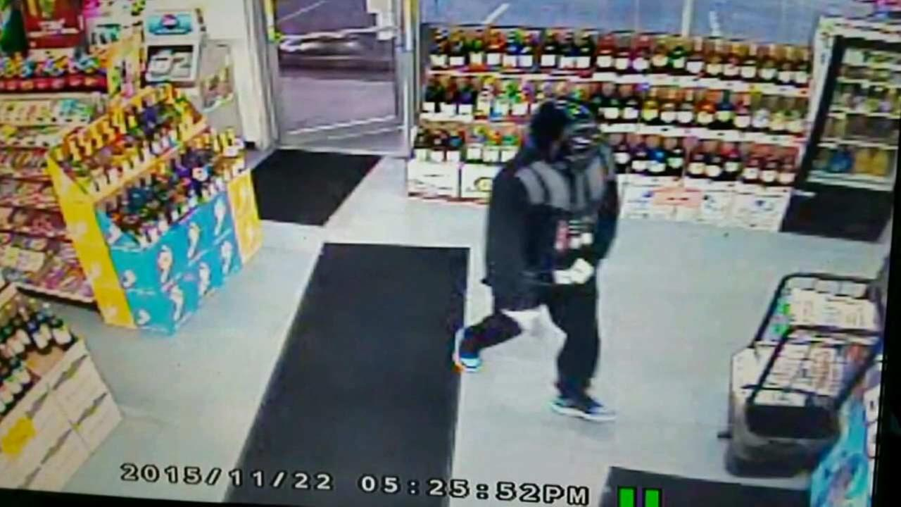 An armed robber dressed as Darth Vader caught on surveillance video inside a convenience store in Florida Sunday, Nov. 22, 2015.