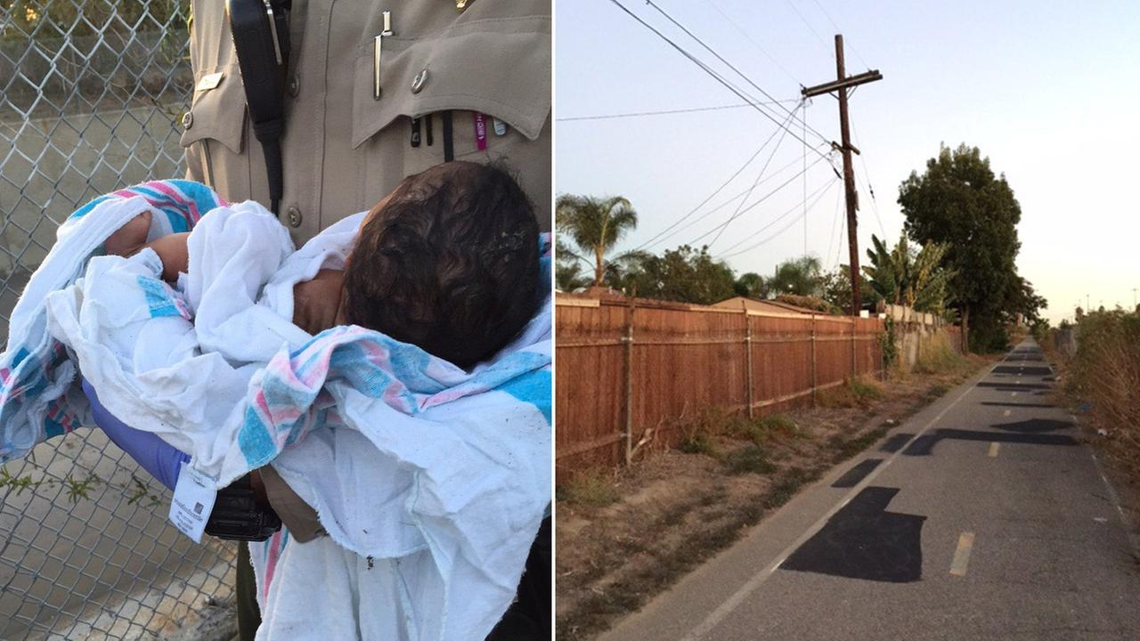 A Los Angeles County sheriffs deputy holds a newborn girl found buried alive near a riverbed in Compton on Friday, Nov. 27, 2015.
