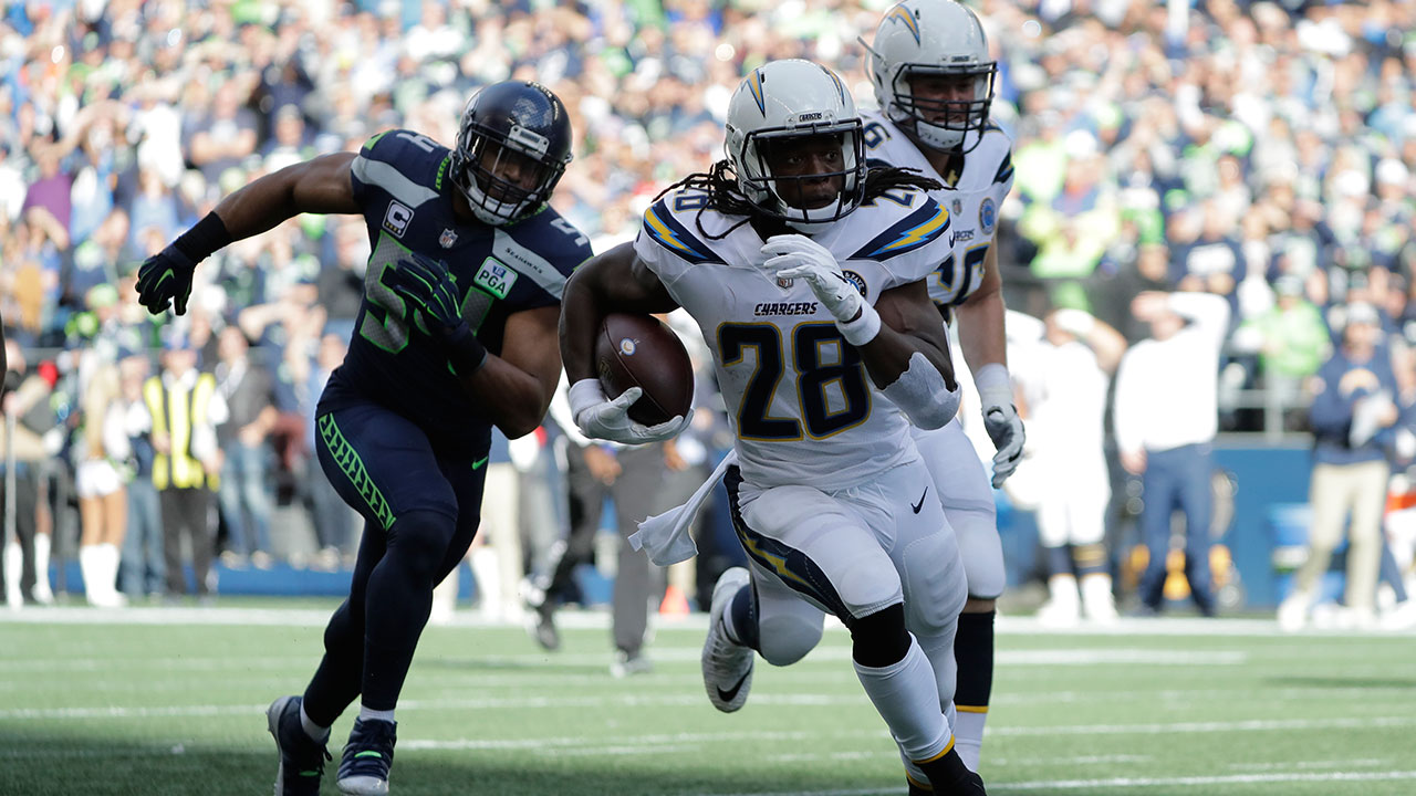 The LA Chargers Melvin Gordon runs for a touchdown against the Seahawks, Sunday, Nov. 4, 2018, in Seattle.