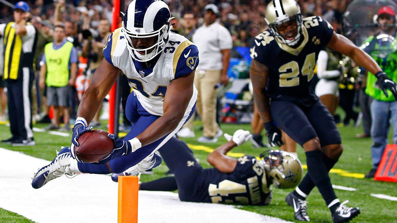 Rams running back Malcolm Brown scores a touchdown in front of Saints free safety Marcus Williams (43) and strong safety Vonn Bell (24) in New Orleans, Sunday, Nov. 4, 2018.