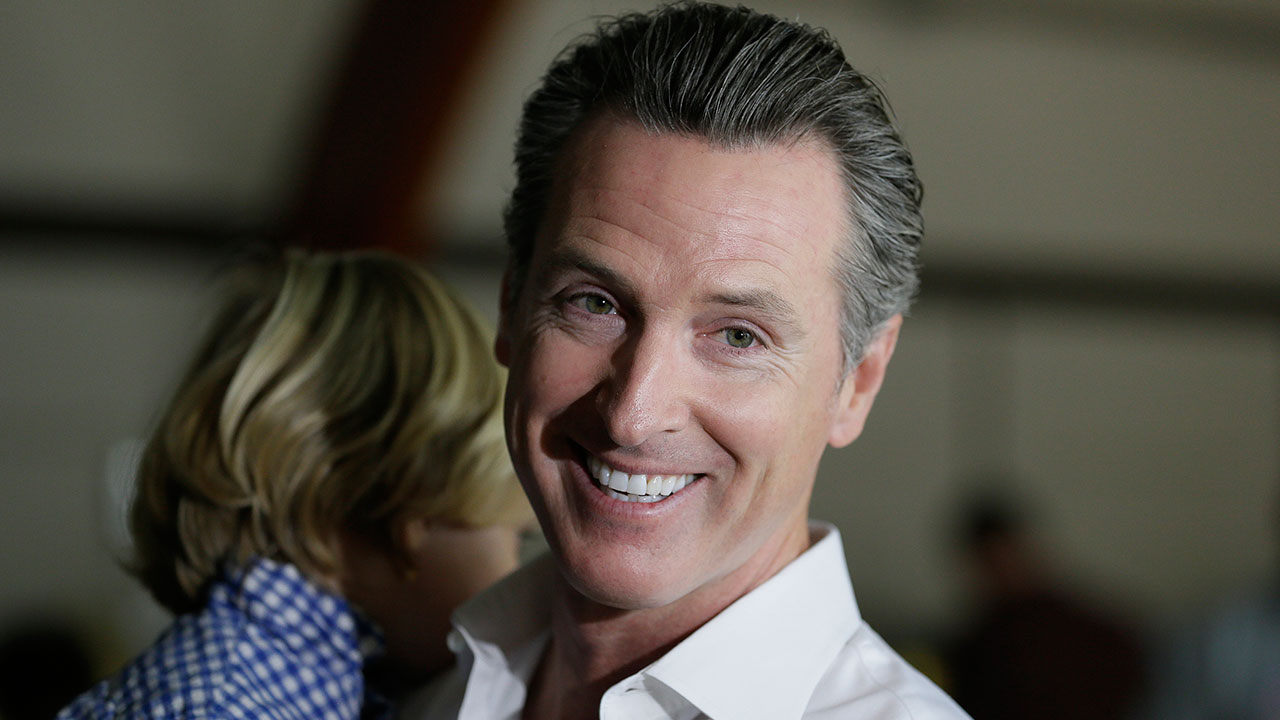 California gubernatorial Democratic candidate Gavin Newsom holds his son, Dutch, 2, while preparing to vote Tuesday, Nov. 6, 2018, in Larkspur, Calif.