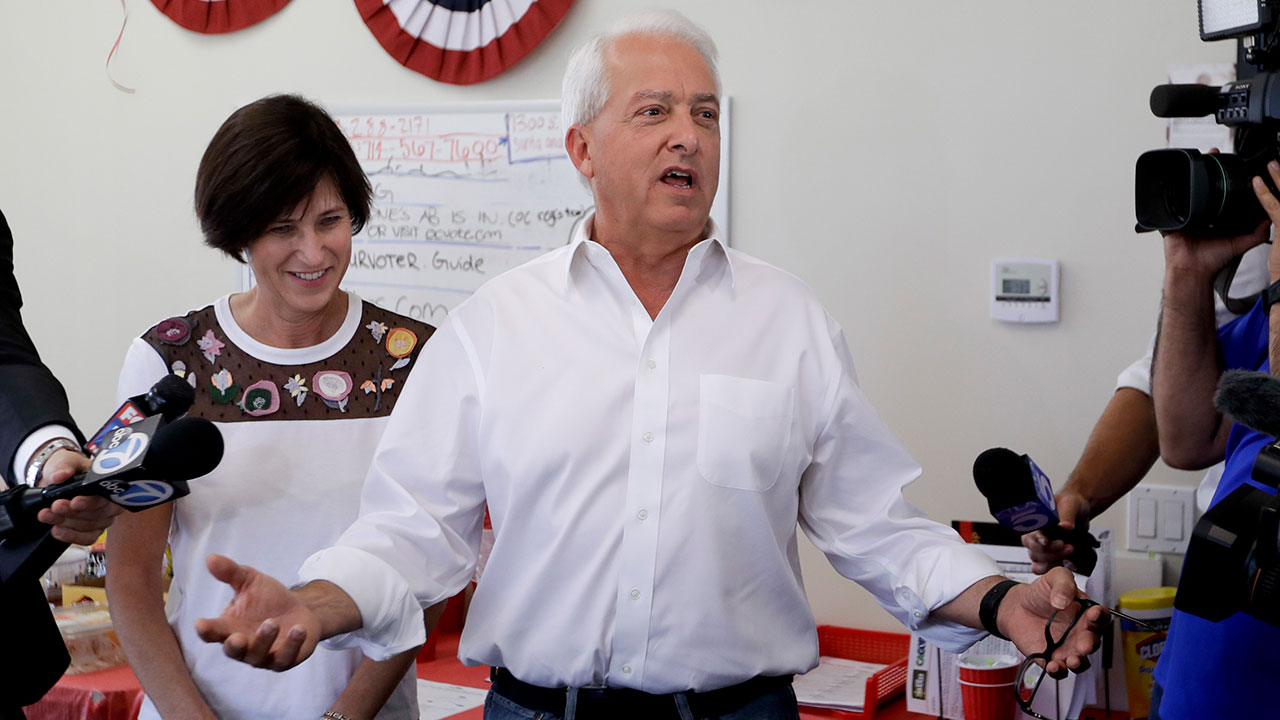 California Republican gubernatorial candidate John Cox speaks during a campaign stop as Rep. Mimi Walters, R-Calif., looks on, Tuesday, Nov. 6, 2018, in Irvine.