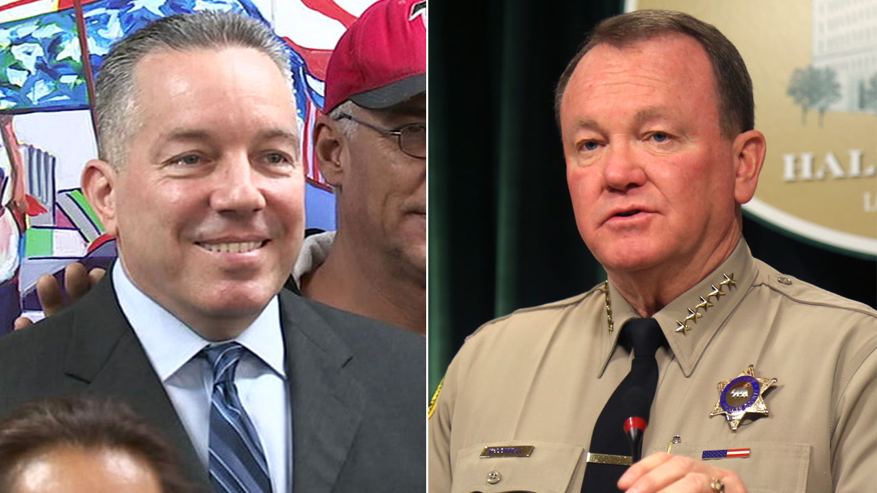 Undated photos of retired sheriffs lieutenant Alex Villanueva and Los Angeles County Sheriff Jim McDonnell.
