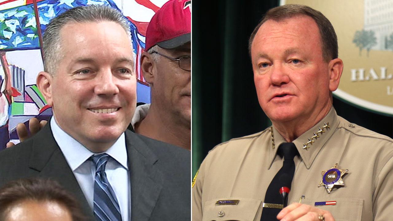 Undated photos of retired sheriffs lieutenant Alex Villanueva and Los Angeles County Sheriff Jim McDonnell.