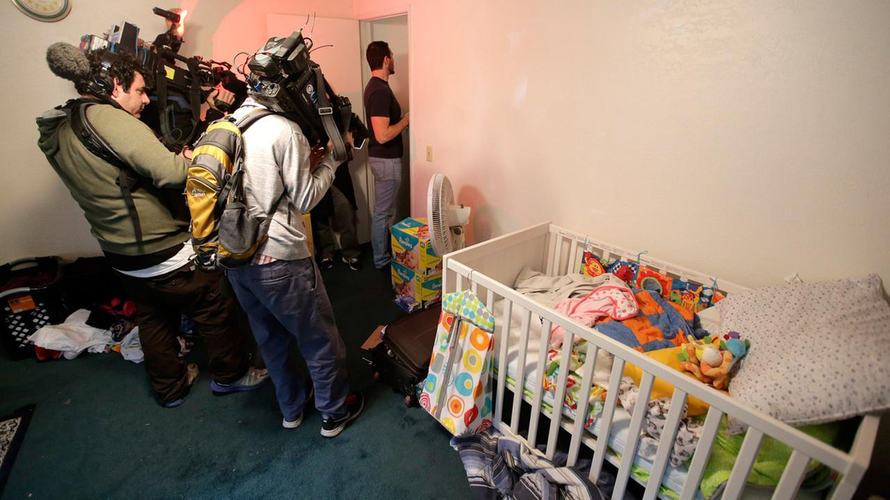 Members of the media crowd into a childs room in an apartment in Redlands, Calif., shared by San Bernardino shooting rampage suspects Syed Farook and his wife, Tashfeen Malik.