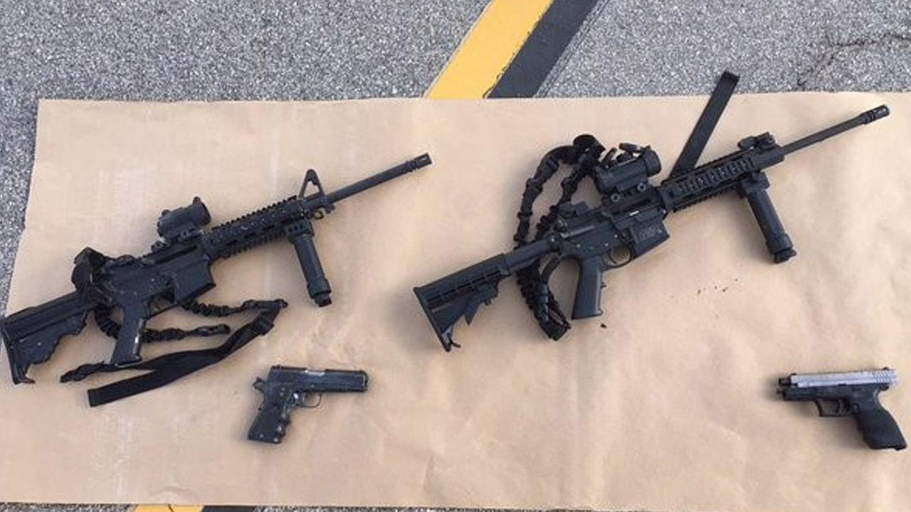 The two assault-style rifles and handguns used in the deadly San Bernardino attacks are shown in an image taken on Wednesday, Dec. 2, 2015.