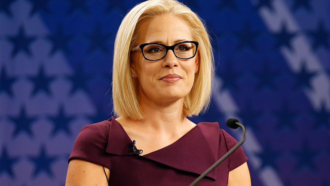 U.S. Rep. Kyrsten Sinema, D-Ariz., goes over the rules in a television studio prior to a televised debate with U.S. Rep. Martha McSally, R-Ariz., Monday, Oct. 15, 2018, in Phoenix.