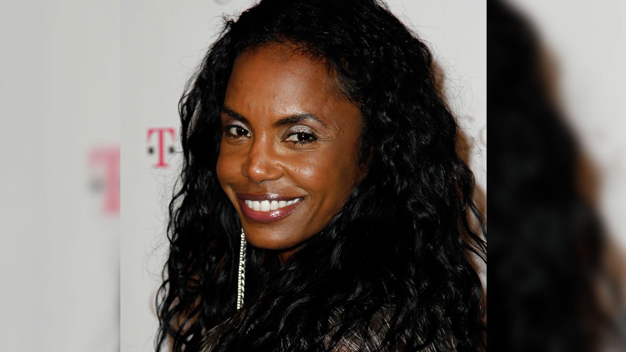 File-This Nov. 16, 2011, file photo shows Kim Porter arriving at the Google and T-Mobile party celebrating the launch of Google Music, in Los Angeles.