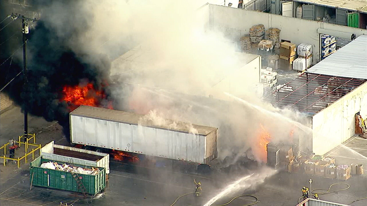 Firefighters battled a blaze at a commercial site at 16616 South Garfield Ave., Paramount that damaged a building and trucks and sent out sparks from a power pole.