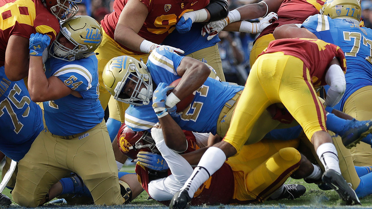 UCLA running back Joshua Kelley scores a rushing touchdown against USC Saturday, Nov. 17, 2018, in Pasadena.