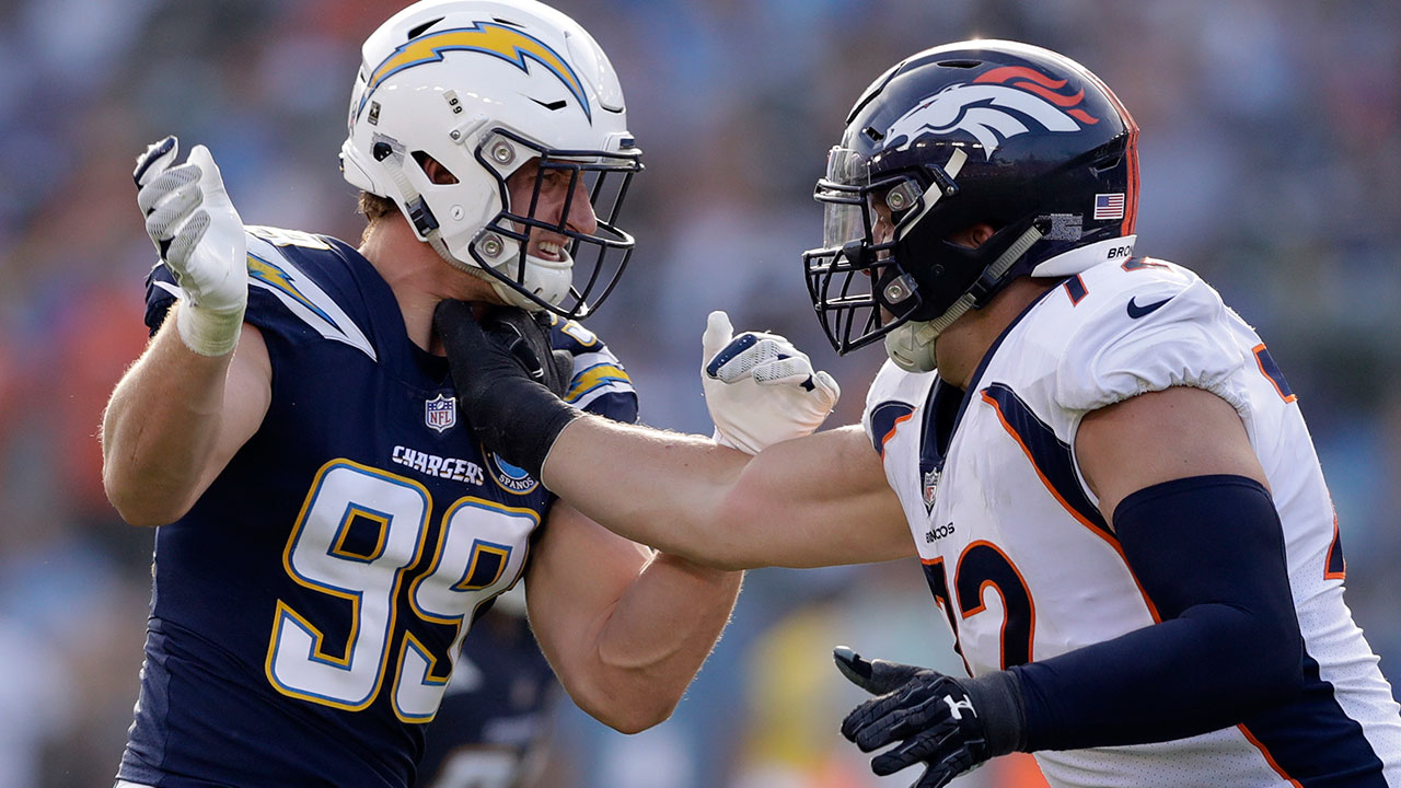 LA Chargers defensive end Joey Bosa, left, lines up against Denver Broncos offensive tackle Garett Bolles during the first half of an NFL football game Sunday, Nov. 18, 2018.