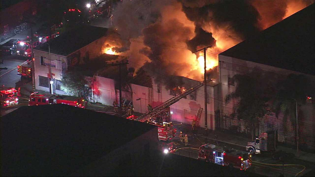 A commercial building was engulfed in flames at Washington Boulevard and McGarry Street in Los Angeles on Friday, Dec. 11, 2015.