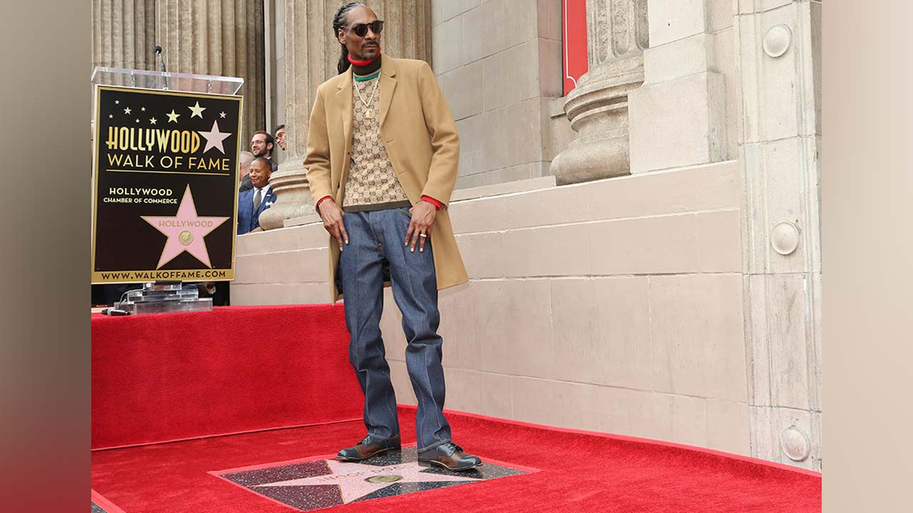 Rapper Snoop Dogg poses atop his new star on the Hollywood Walk of Fame following a ceremony in his honor on Monday, Nov. 19, 2018, in Los Angeles.