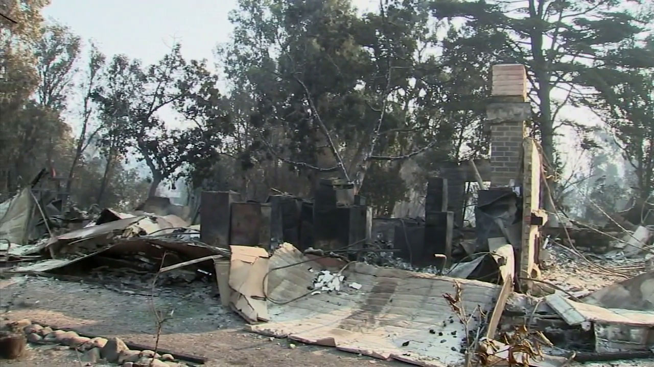 The rubble of a home destroyed in the Woolsey Fire is shown in a file photo.