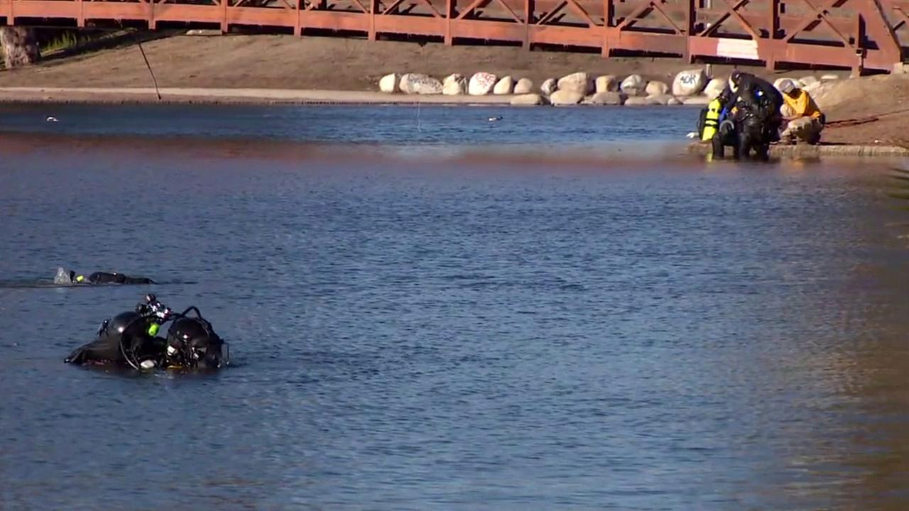 An FBI dive team scours a San Bernardino lake to find any evidence linked to the Dec. 2 terror attack.