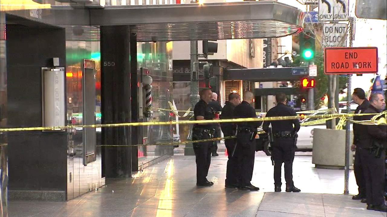 Law enforcement officials are shown outside The Standard Hotel in downtown Los Angeles following a shooting on Sunday, Dec. 13, 2015.