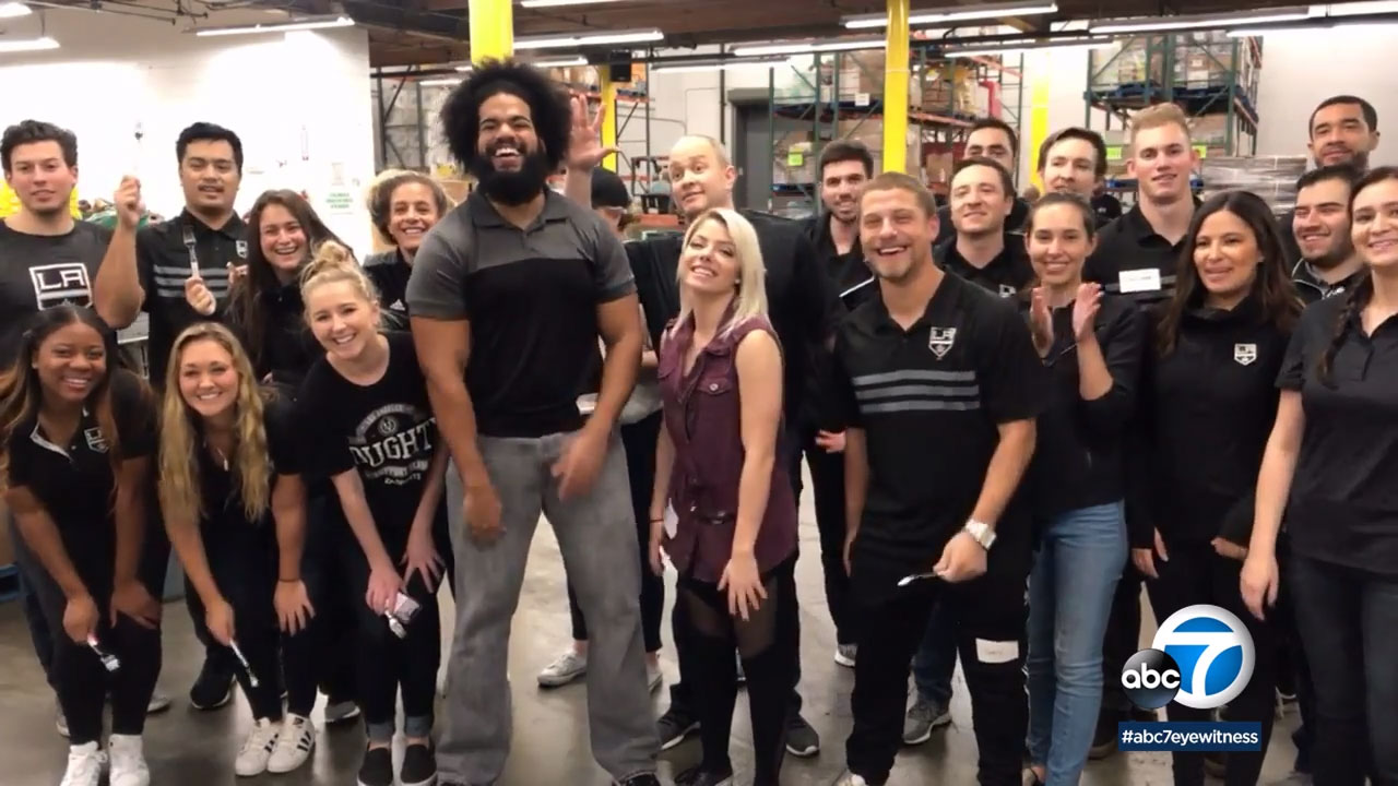 Members of the Los Angeles Kings and WWE helped pack meals for those in need at the LA Food Bank.