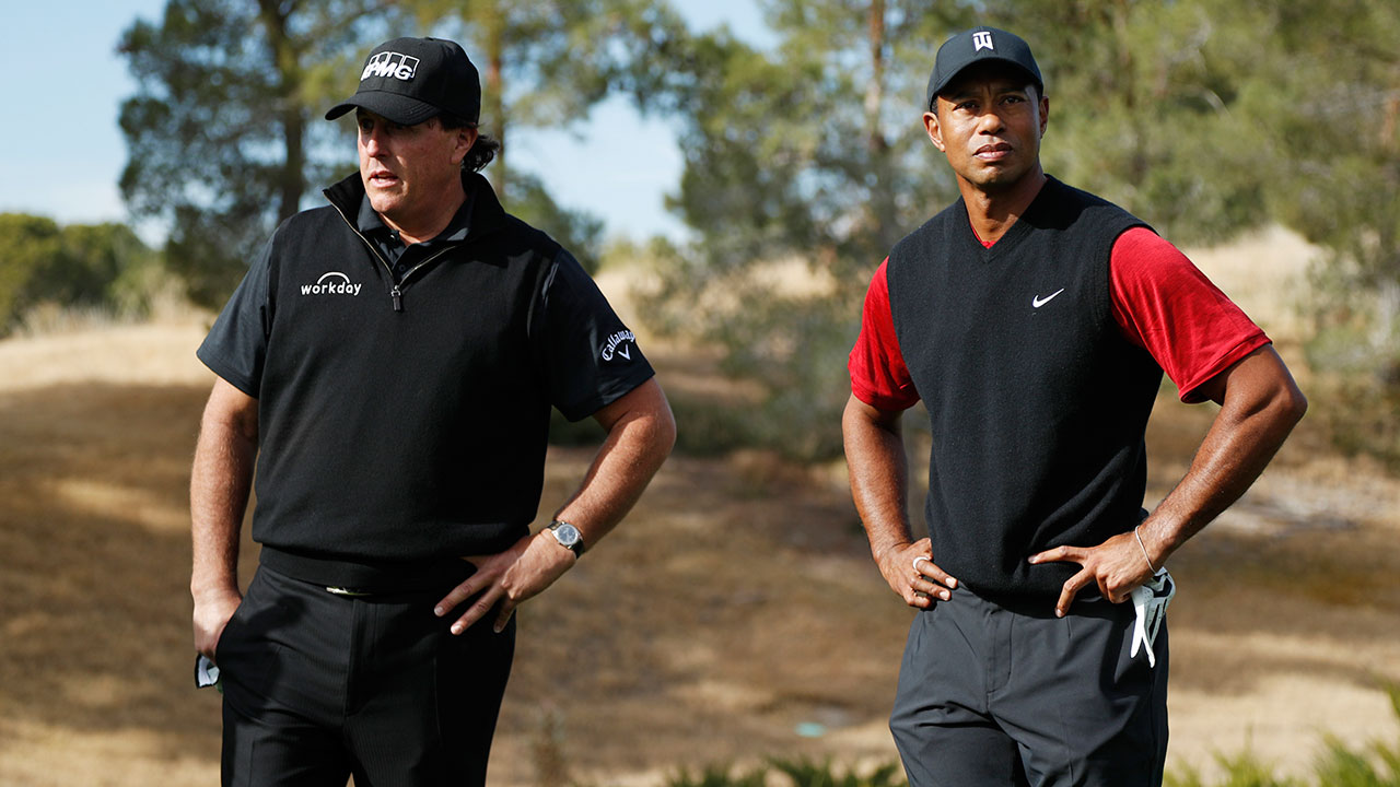 Phil Mickelson and Tiger Woods stand at the first tee before a golf match at Shadow Creek golf course, Friday, Nov. 23, 2018, in Las Vegas.