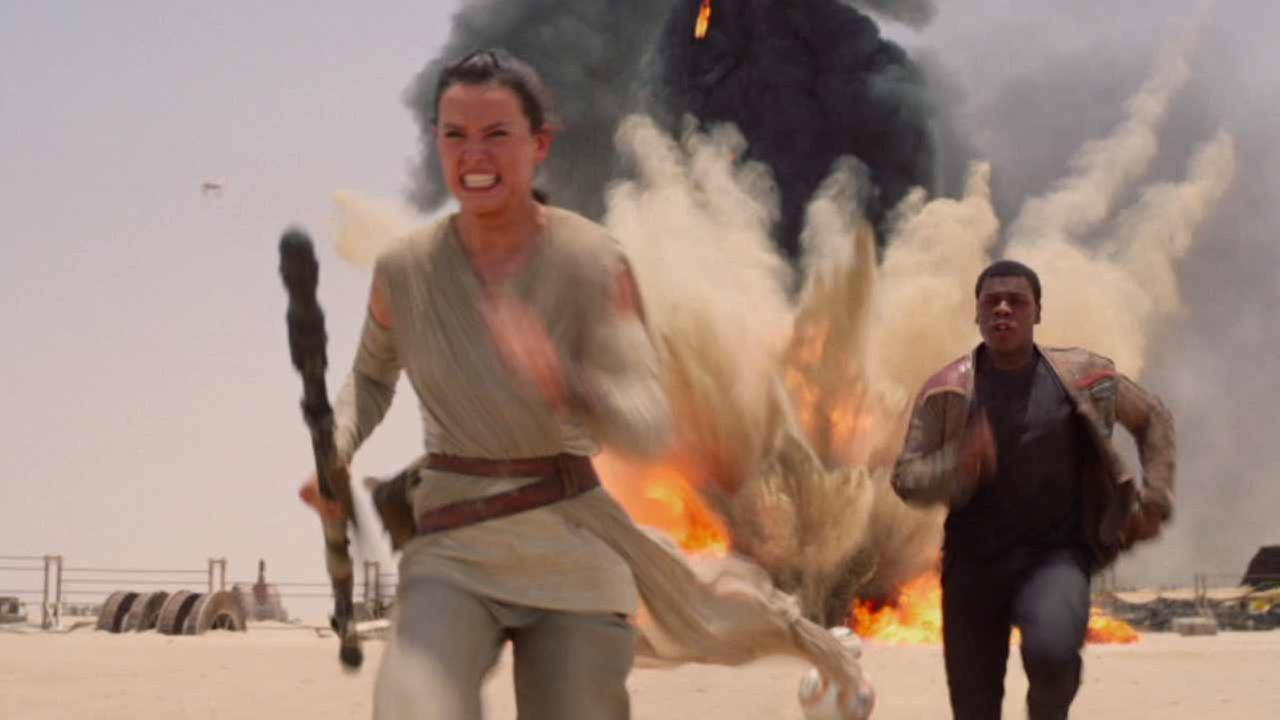 This photo provided by Disney/Lucasfilm shows Daisy Ridley, left, as Rey, and John Boyega, right, as Finn, in a scene from the film, Star Wars: The Force Awakens.